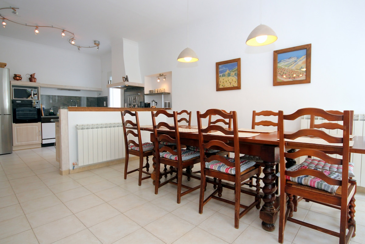 Dining table and kitchen in 50sqm open plan living space