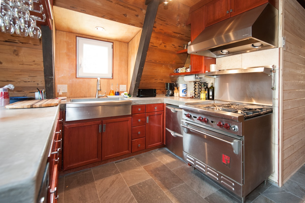 Kitchen with Wolf range and stainless steel appliances
