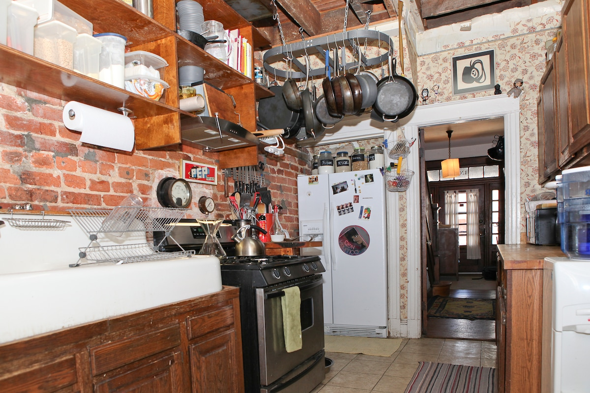 Kitchen with the original farm sink, modern stove with convection oven, and plenty of pots and pans... I love to cook!