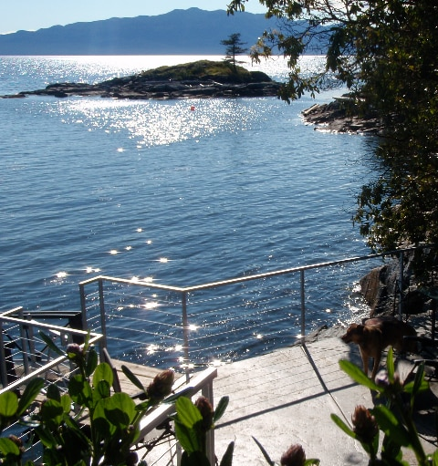 The lower patio at Longhouse Bay getaway, you can access the dock here or lounge at the waterfront