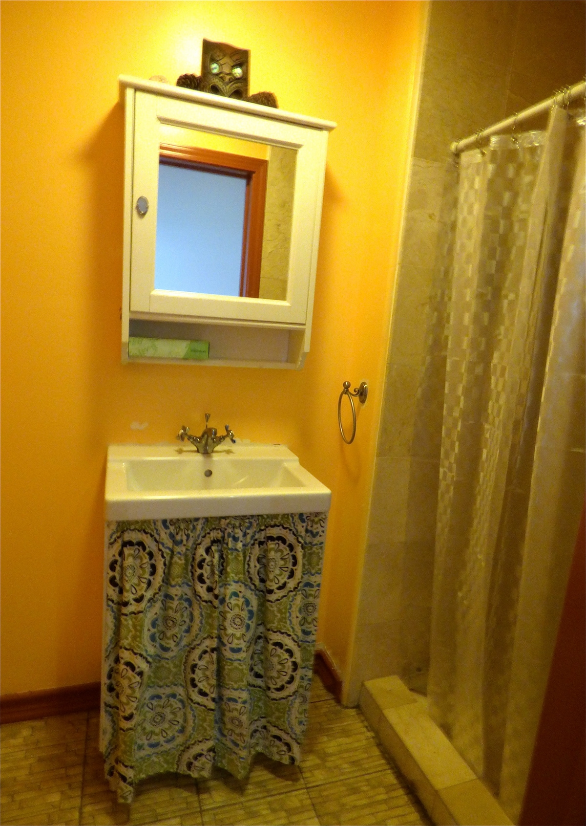 Second bathroom. Shower stall, sink, and toilet.