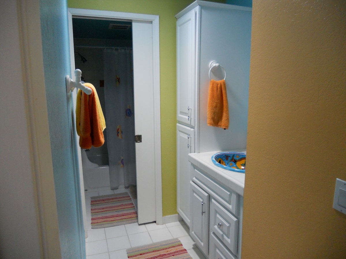 Colorful shared bathroom with only one other person.(also use of 1/2 bath downstairs)