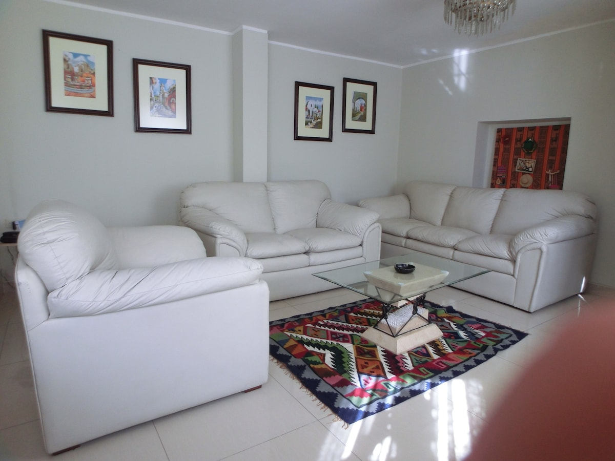Living room decorated with 'aquarela' paintings bade by local artists.