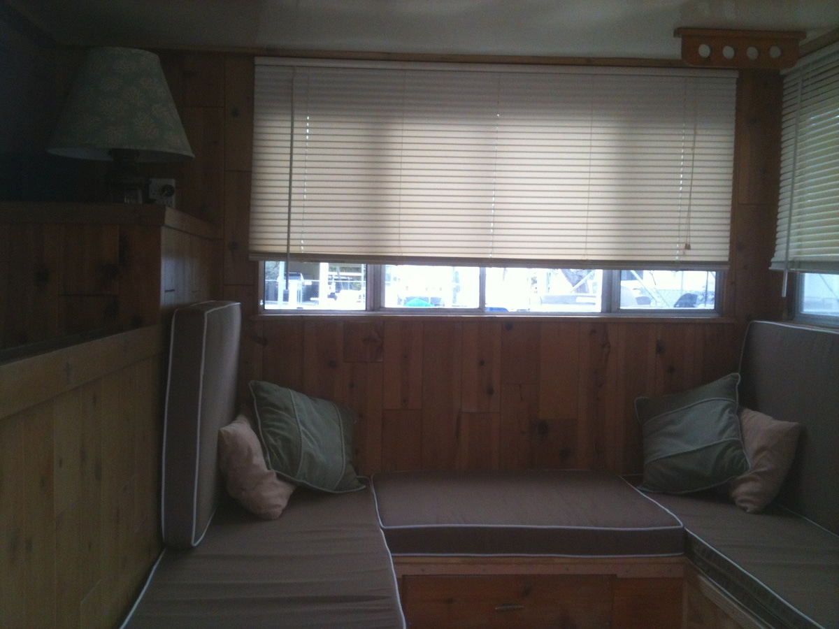 dock level, front salon at the bow; converts to two singles or generous memory foam Queen bed;