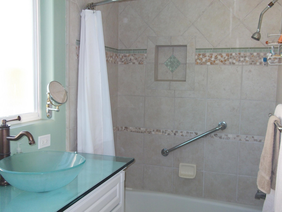 Glass bowl sink and gorgeous tile work