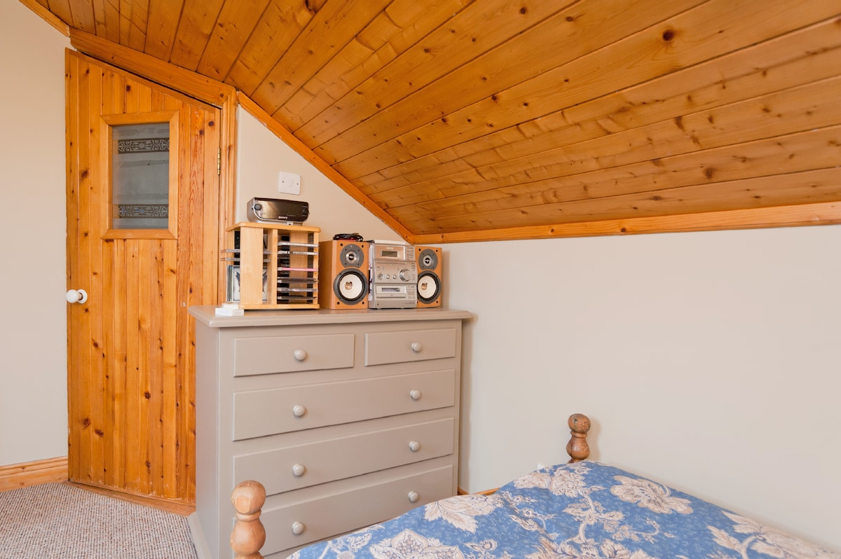 Furniture includes a chest of drawers, bedside locker, set of smaller drawers, desk and chair, rocking chair and table.