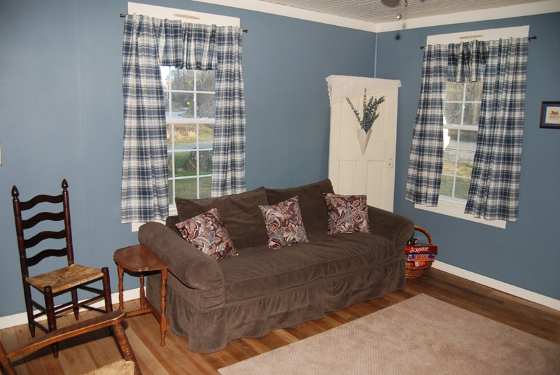 The living room has comfortable seating and a gas log stove.