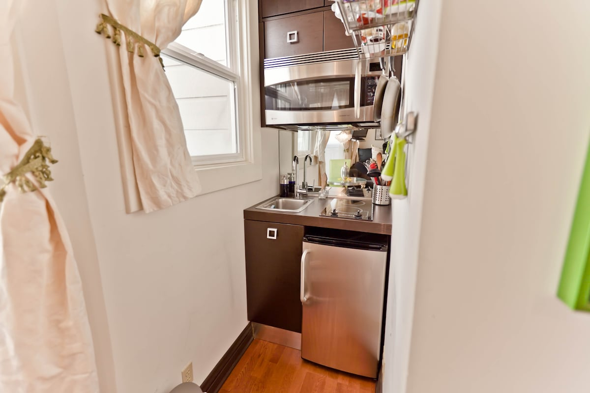 Kitchen: microwave convection over, two burner stove, fridge