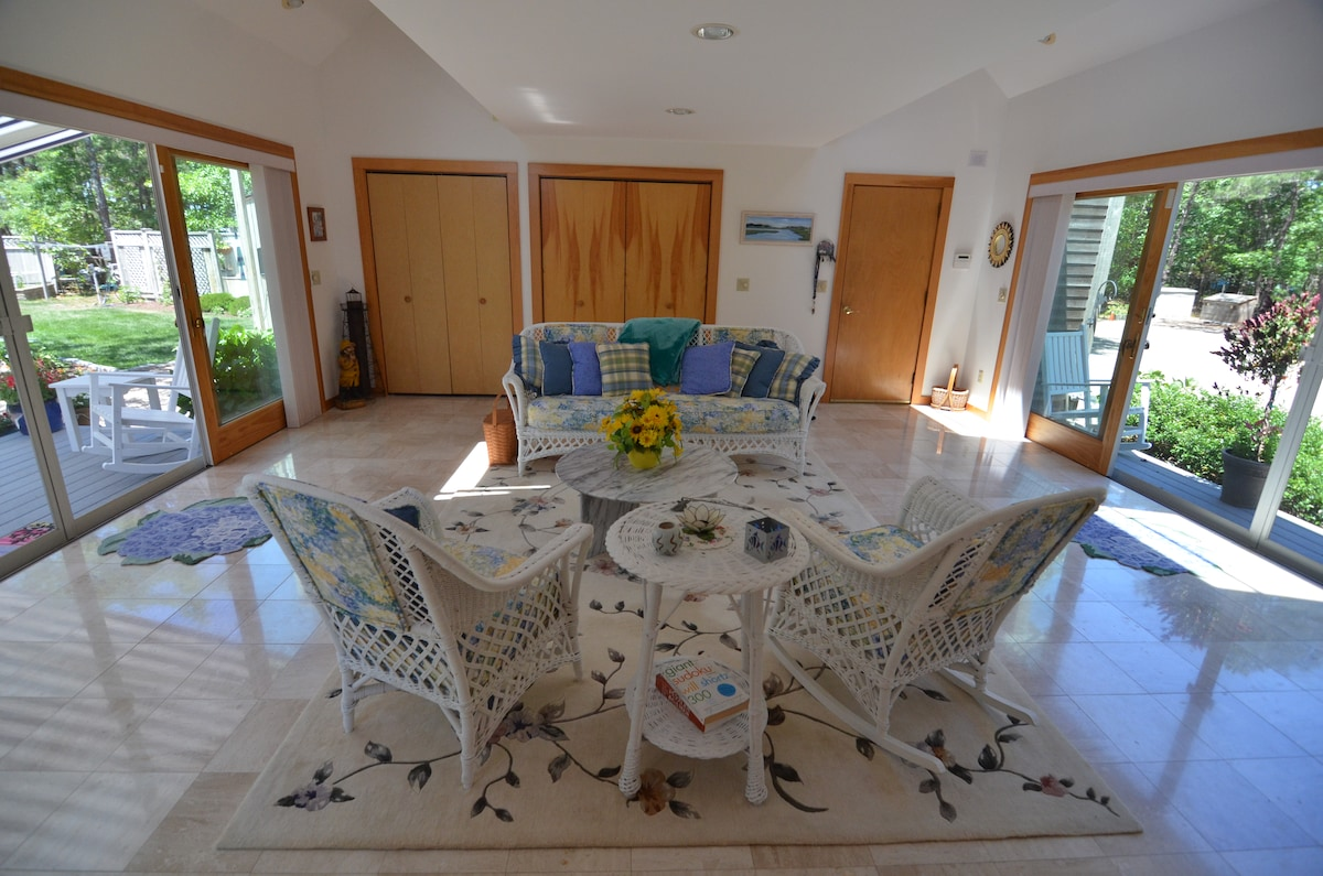 Breezy Sun room-  a bright quiet place for our guests to read and relax