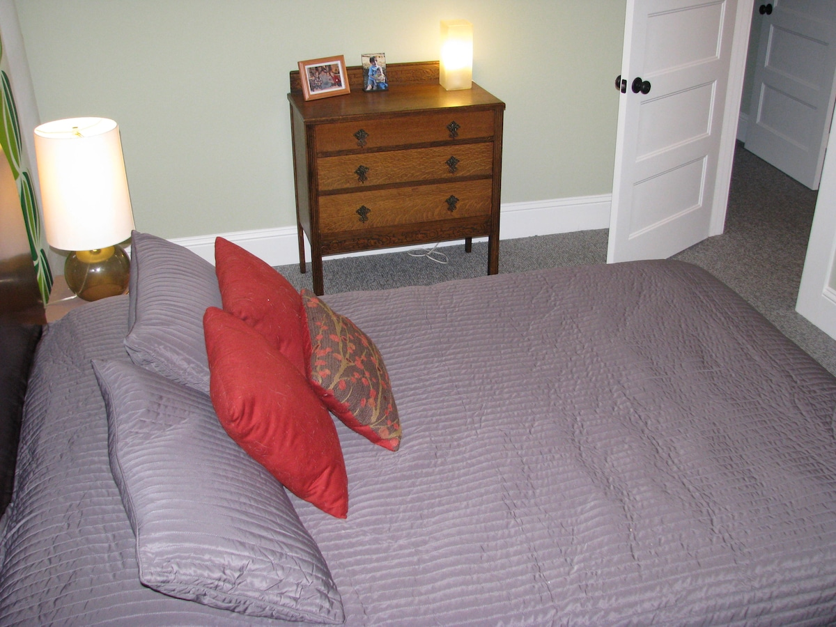 Room includes a large closet with hanging space for clothes and shoes.