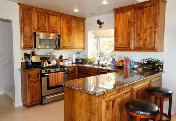 This is the fully equipped kitchen with granite counter tops.