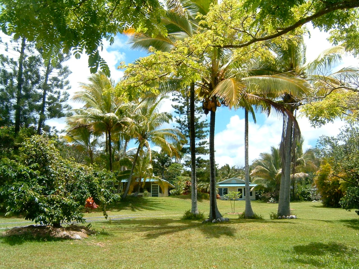 Lava Lane Cottages are set in a private 6 acre tropical garden. The Palms Cottage is on the left, the Bamboo Cottage is on the right