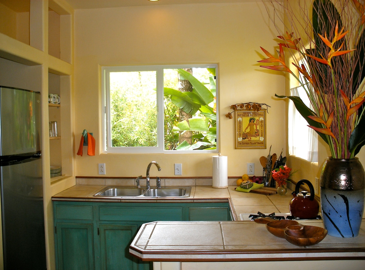 The island style kitchen has a full size refrigerator, double sink, four burner cook-top, and everything you need to prepare a nice meal. It is a culinary paradise!
