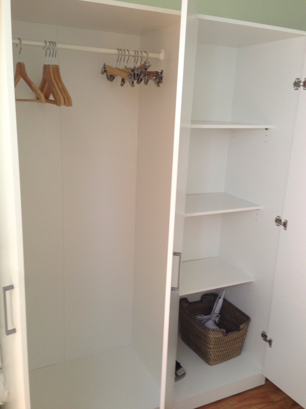 Large wardrobe with hangers and shelves; phone charger, plug adapters, and a hair dryer are all available for your use