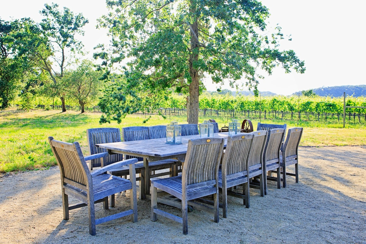 Dine al fresco overlooking vineyards and mountains.