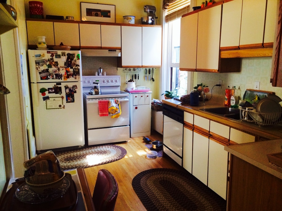 Large kitchen that looks out onto deck