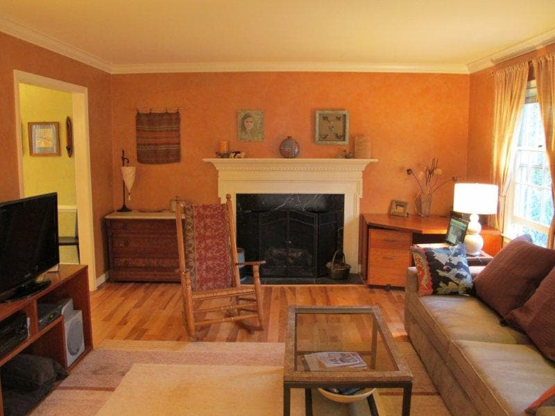 Living room features gas fireplace comfy couch and seating for 5. Large flat screen with cable, dvd and surround sound.