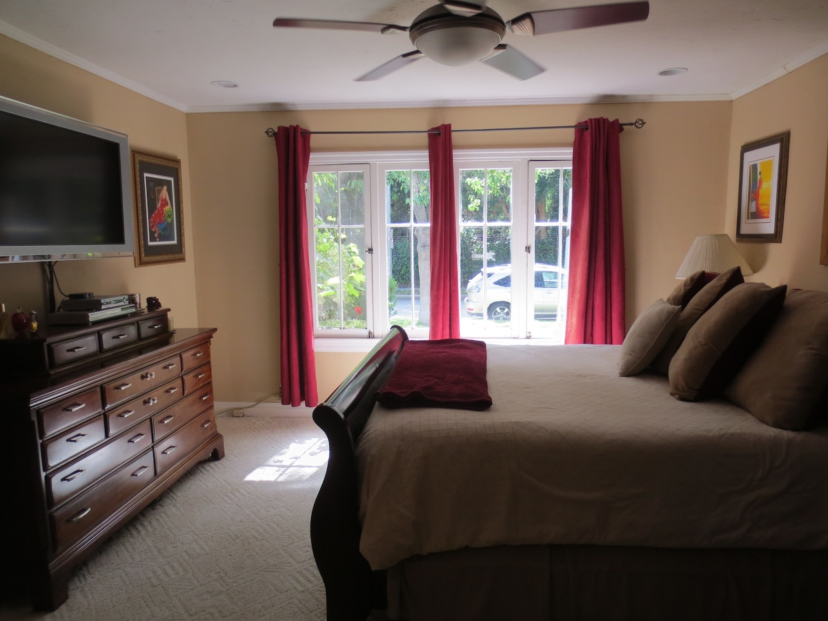 """Large master bedroom with California King Bed 56"""" flat screen cable TV"""