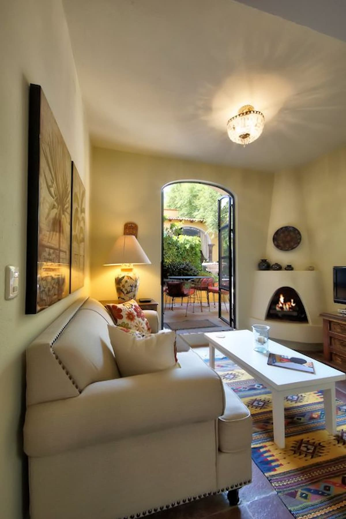 The living room features a gas fireplace for those cool winter morning and evenings.  Access to your own garden patio is off the living room and is very private. Feel free to pick any oranges from the orange tree.