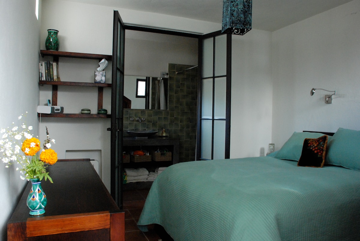 Master bedroom has Queen-sized bed and ensuite full bathroom.