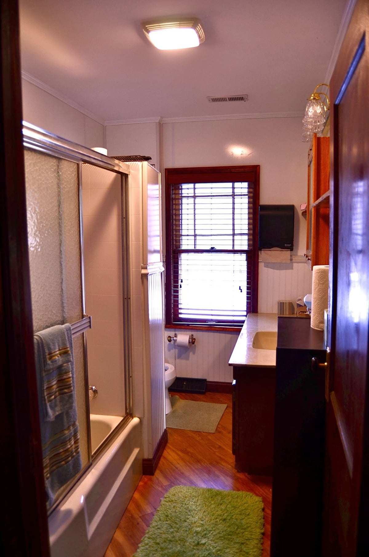 Common full bath on the second floor, directly across the hall from this room.