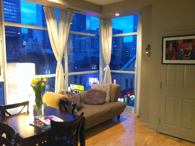This room has 12 foot ceilings, on the north east corner of  Yonge and Wellesley st. Prime downtown location