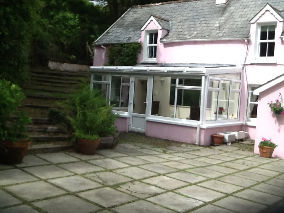 Steps up to Master Bedroom, other steps inside, and private conservatory