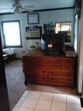 more of the main living area, dresser, TV w/DVD player and cable