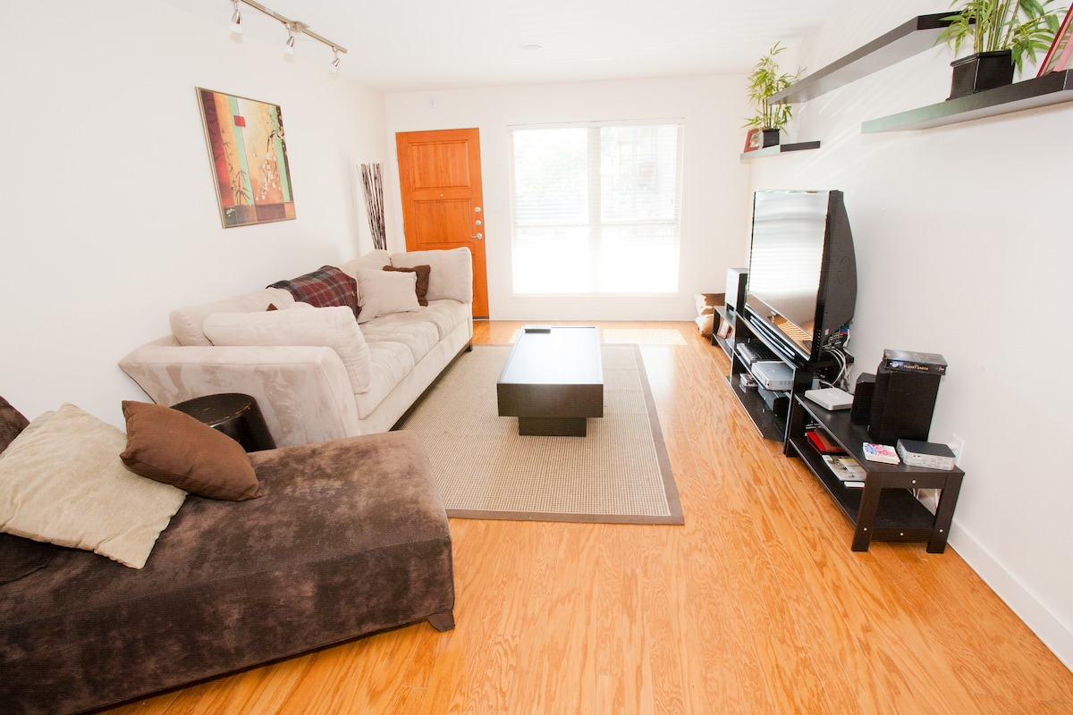 """Living room with natural light.  56"""" Samsung LCD TV with satellite cable, showtime, DVD and Surround sound"""