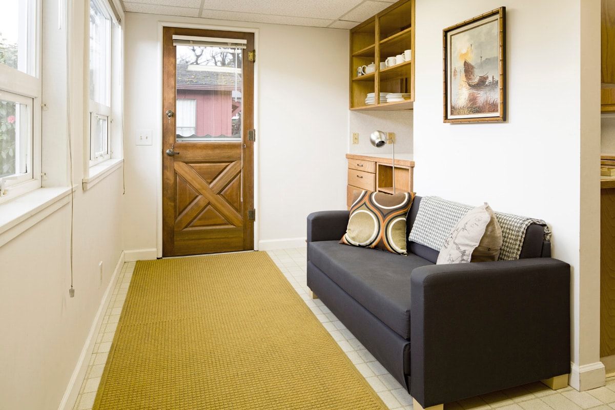The entry area to the large front yard has a double sleeper sofa for an extra sleeping area.