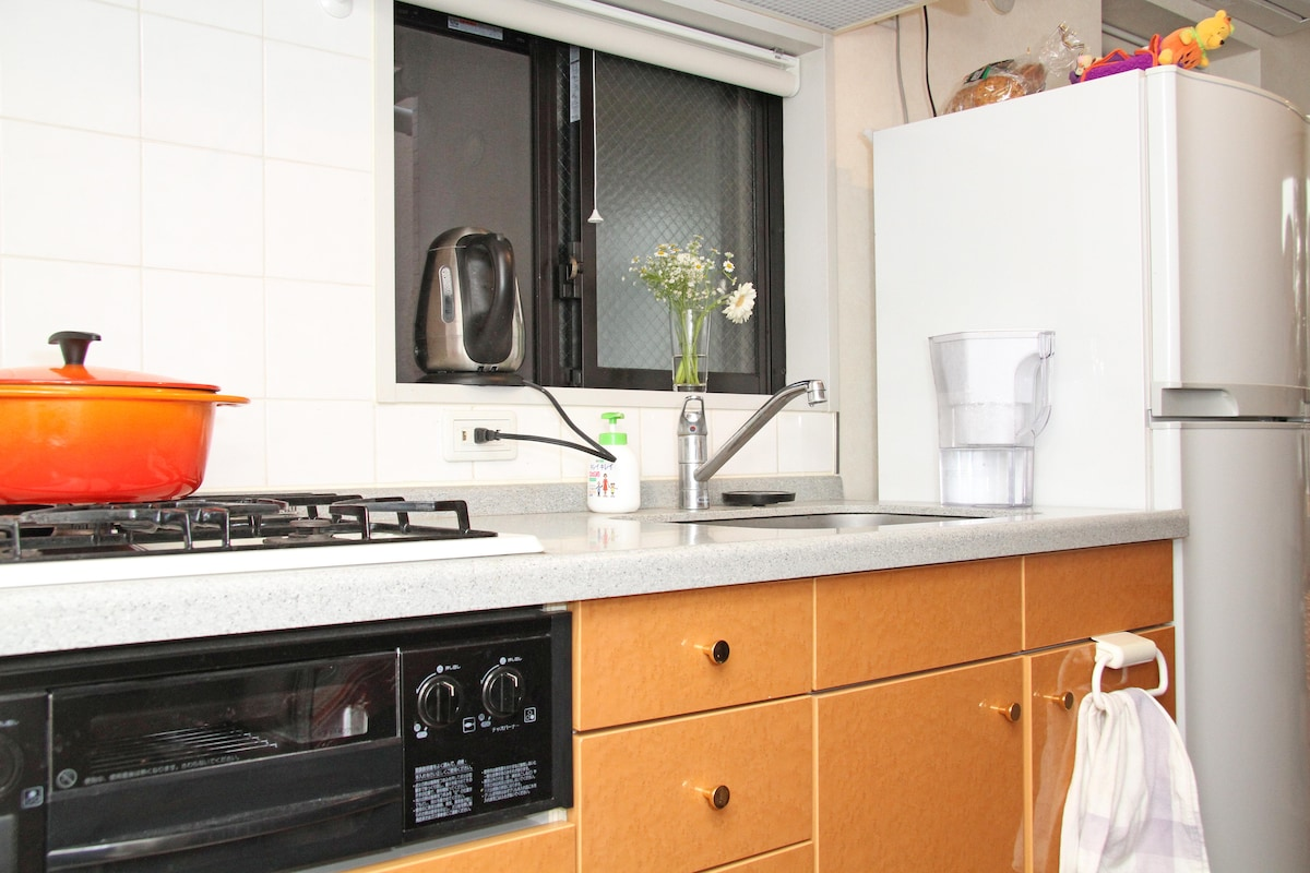 Kitchen with Coffee Maker, Microwave, Pots etc.