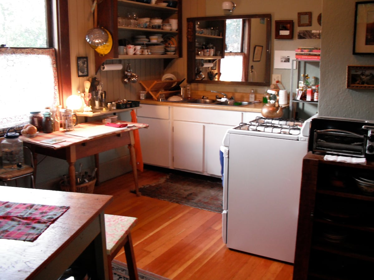 Sweet little gas stove, french press, toaster, iron/ironing board...what every kitchen needs.