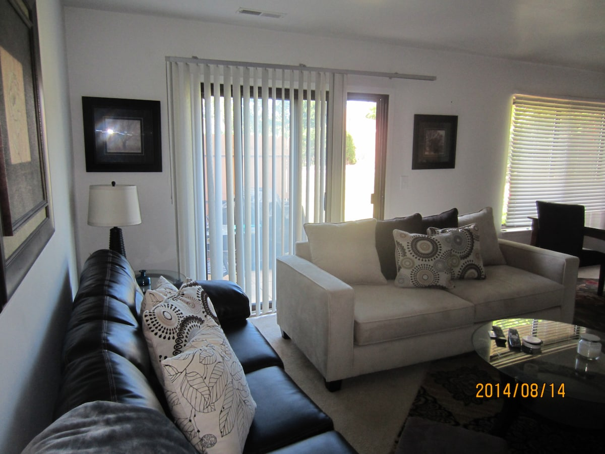 Living Room area with sliding doors to small patio