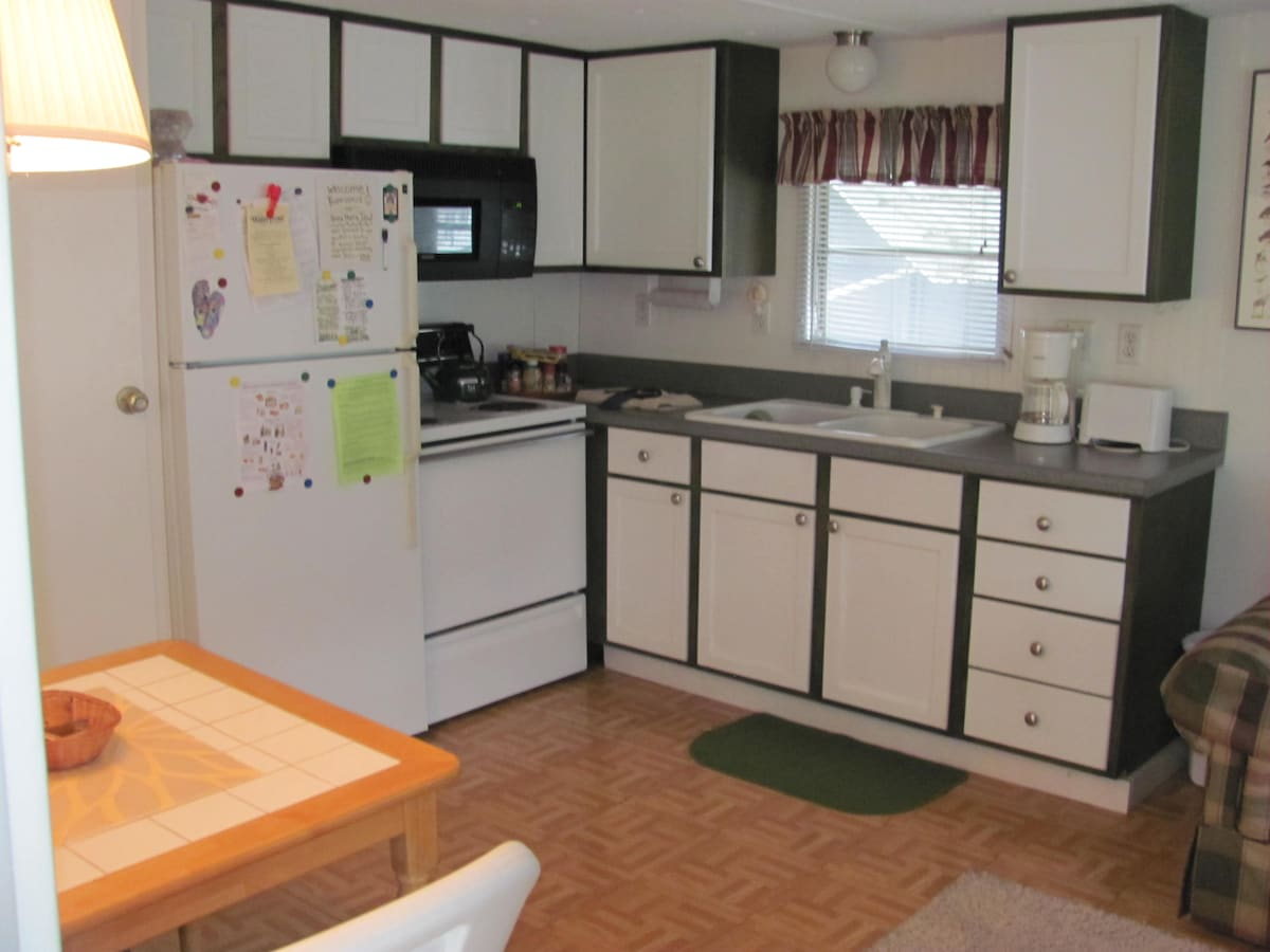 Kitchen complete with new appliances and cooking utensils for everyone who likes to cook.