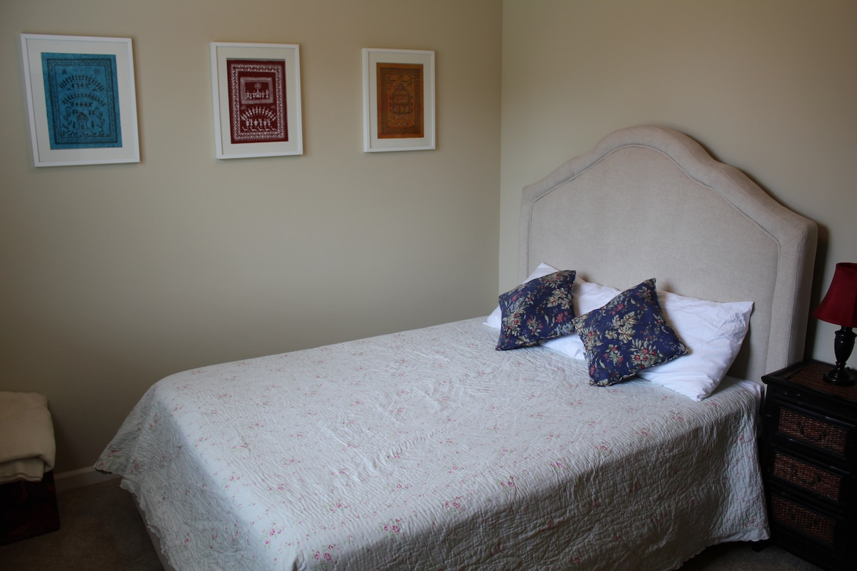 Queen bed with pillow top mattress for a good night's sleep.