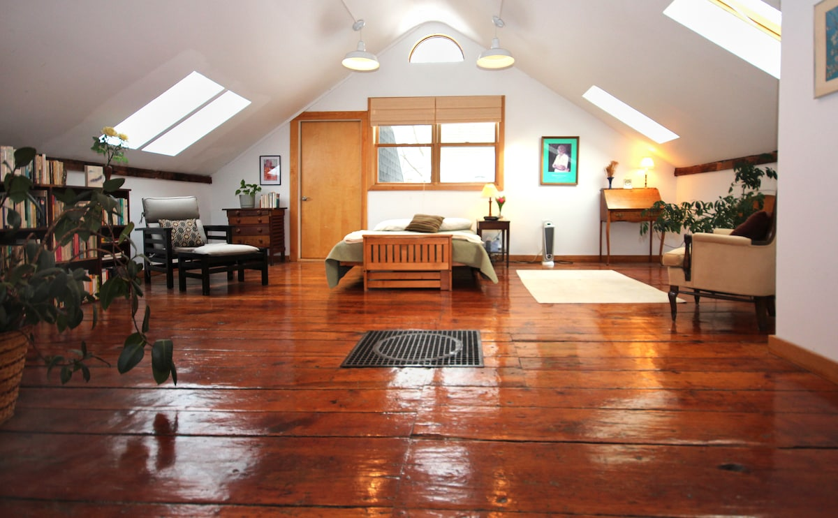The bedroom is on the second floor. Beautiful original wood floors.
