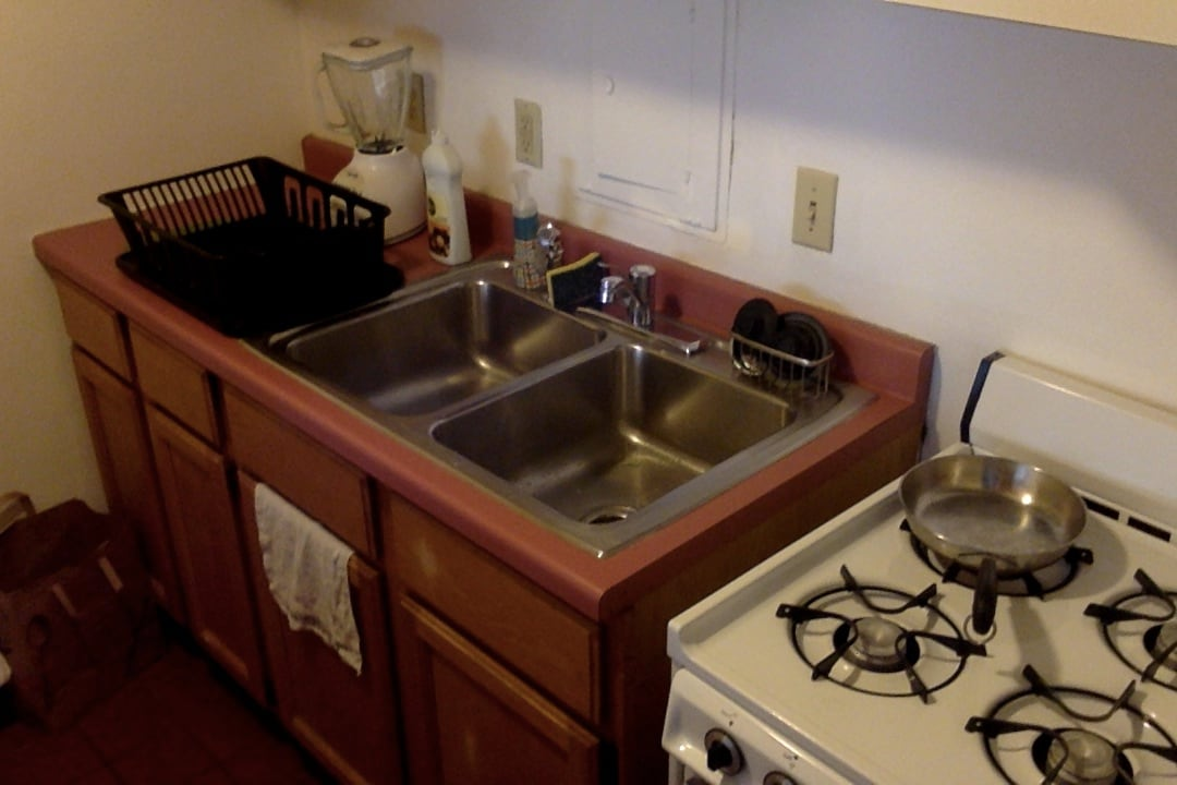 Compact kitchen with gas stove.