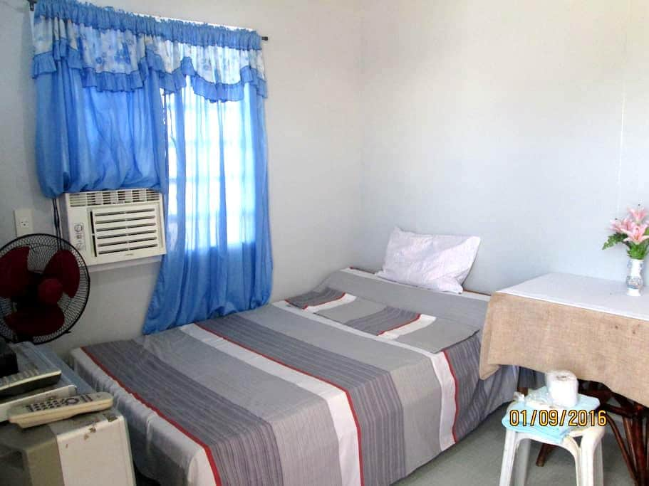 A Modest Air-conditioned Room - Davao City - Talo