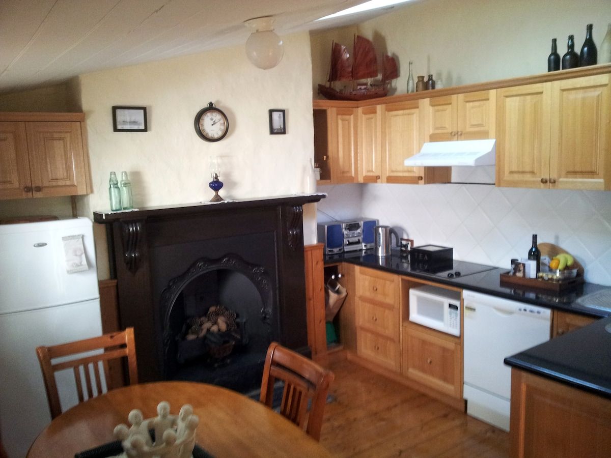 A charming kitchen eminating of cottage history, yet fully appointed for cooking and sharing a meal.
