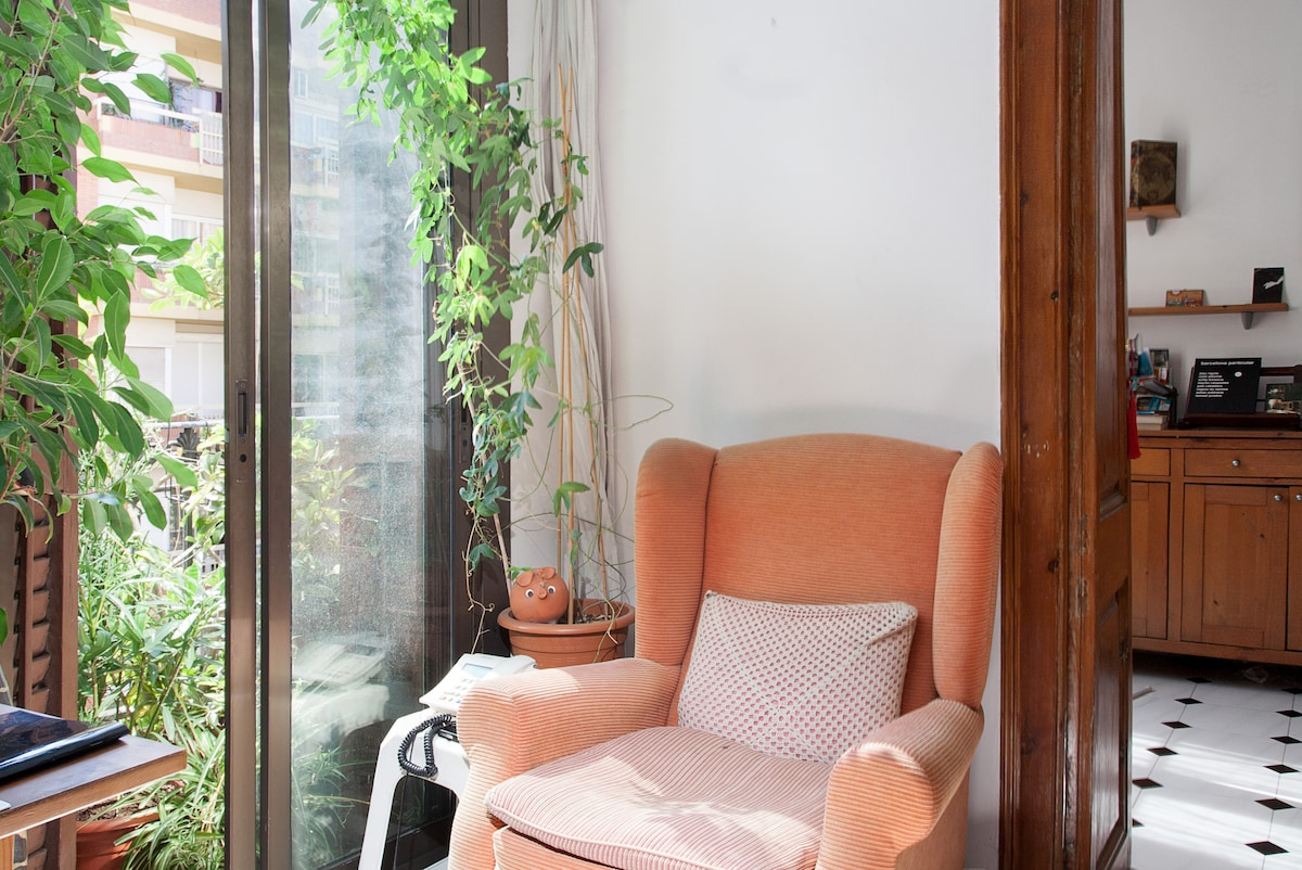 A (confy) sofa next to the window, just next to your room.