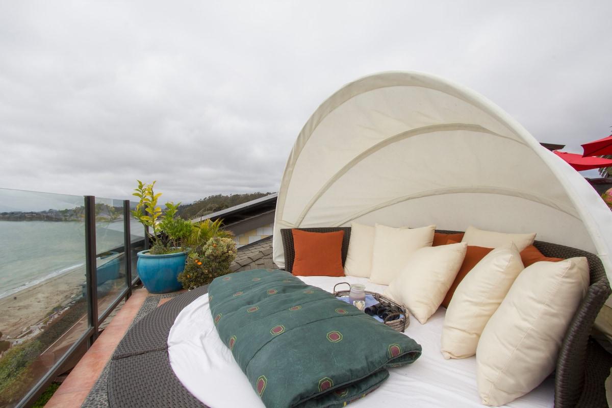 Queen bed on rooftop deck.