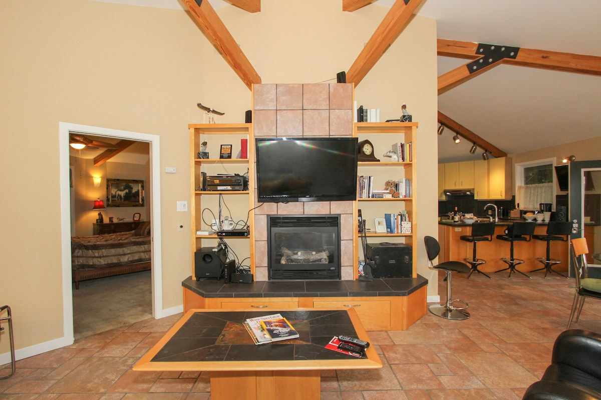 Owner's suite is separated by vaulted living area from guest bedroom/bath