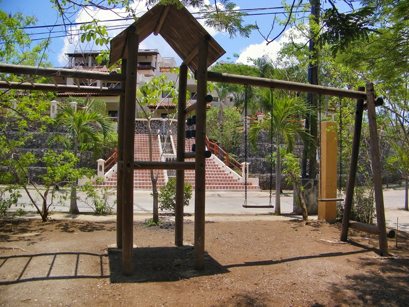 Playground right off the main entrance for the kids to enjoy swings and more!