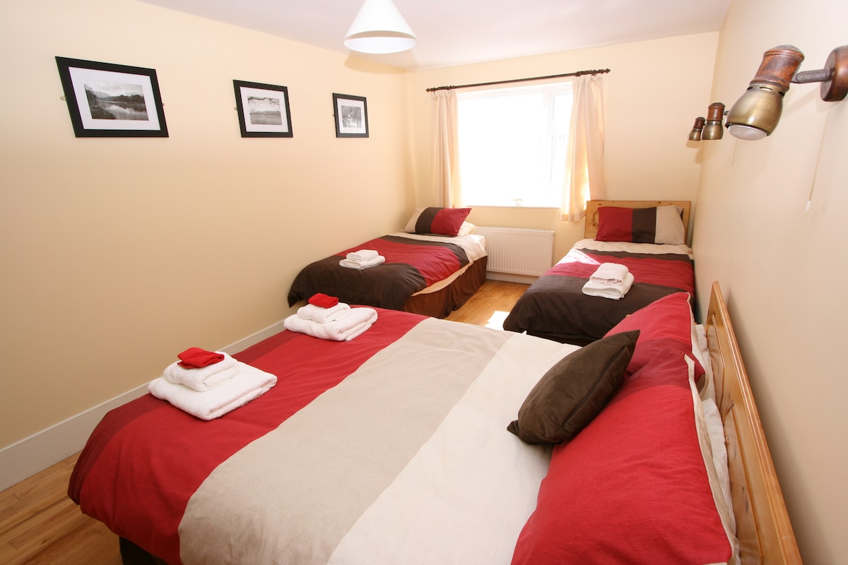 Bedroom 1 -double & two single beds