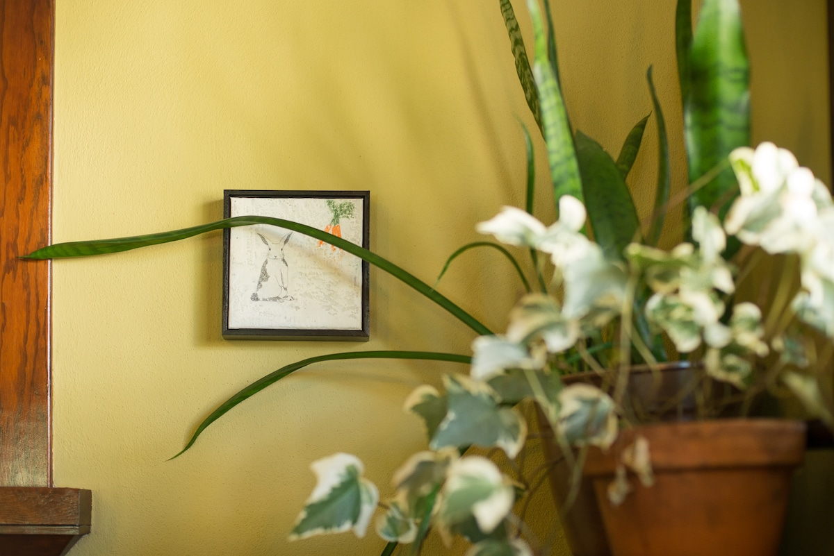 Local art and little treasures are  tucked all over the house.