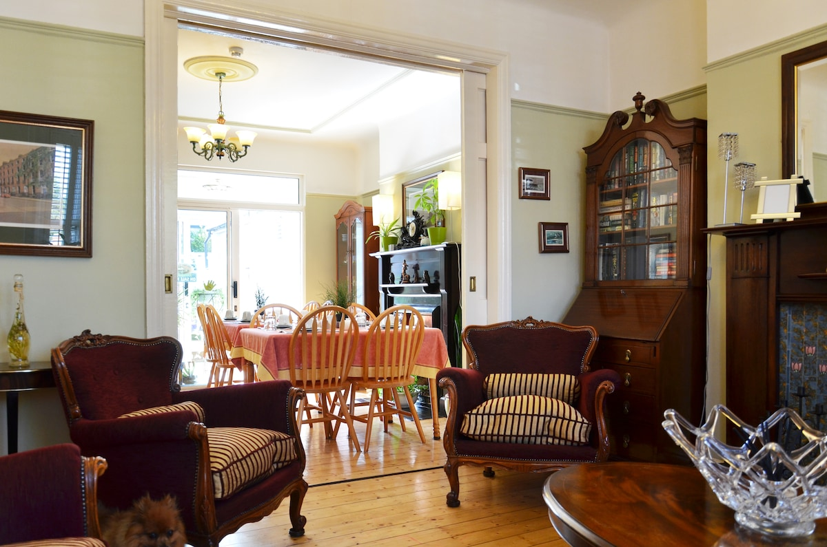 The sitting room with a view of the dining room