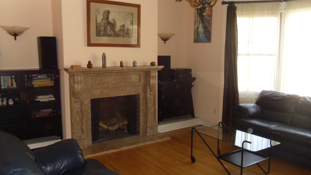 Family room with gas fireplace and pocket doors for romantic/quiet getaway.