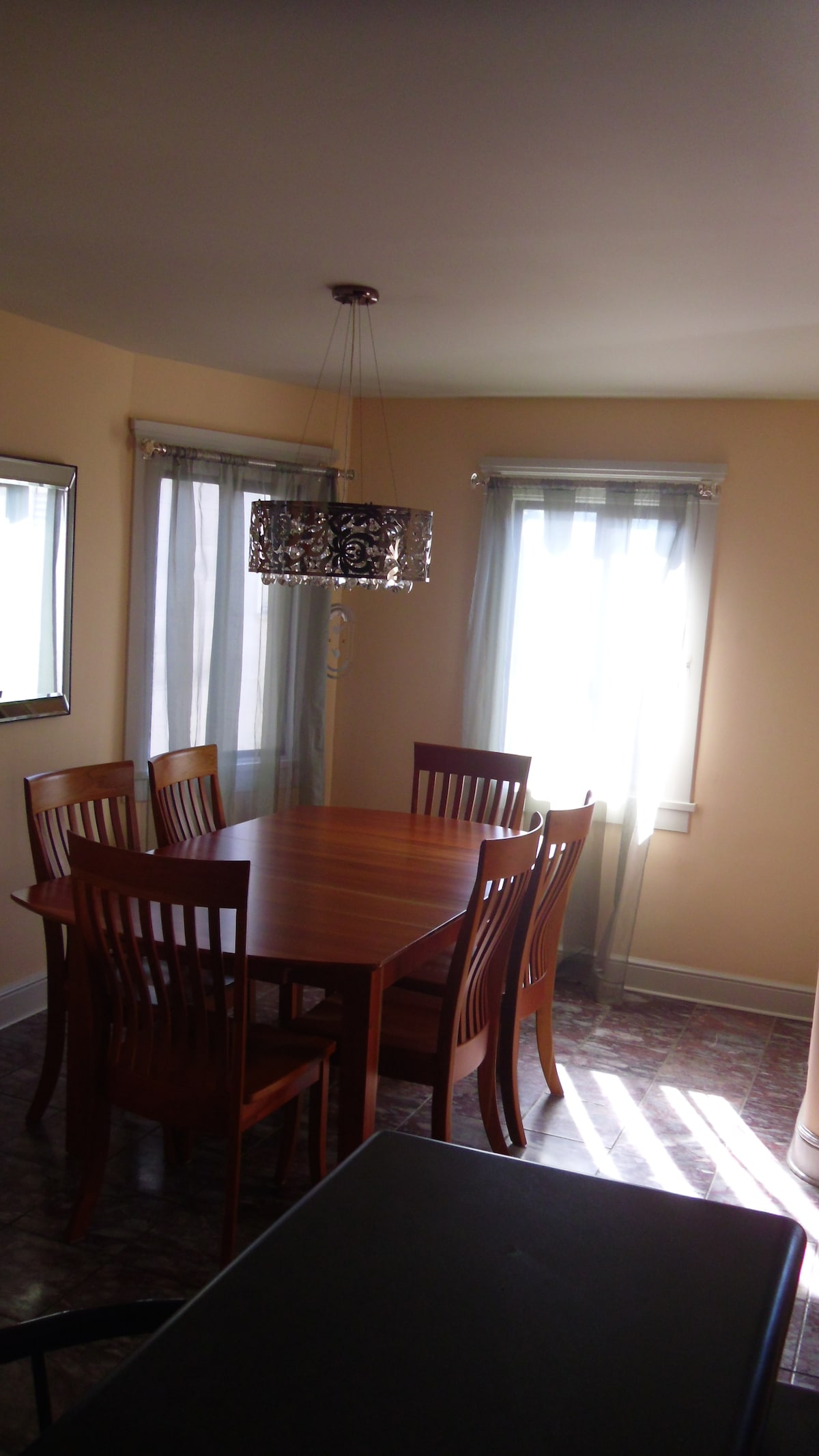 Large dining area with cherry table and chairs.