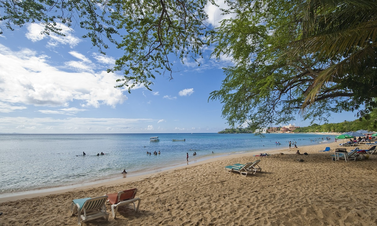 The dreamy sand of Sosua Bay.  Swimming, snorkeling and diving from the beach.