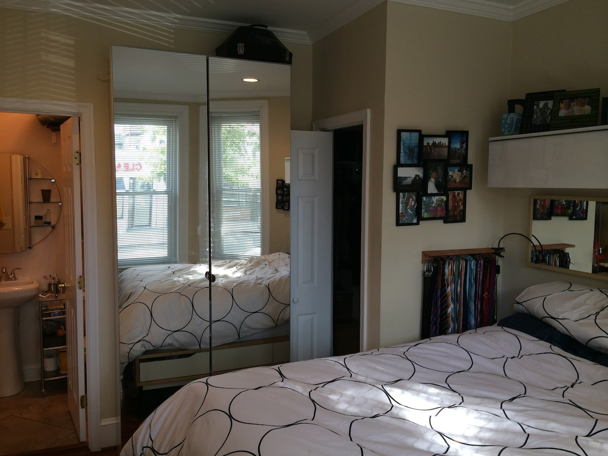 Bed and bath in modern DC rowhouse